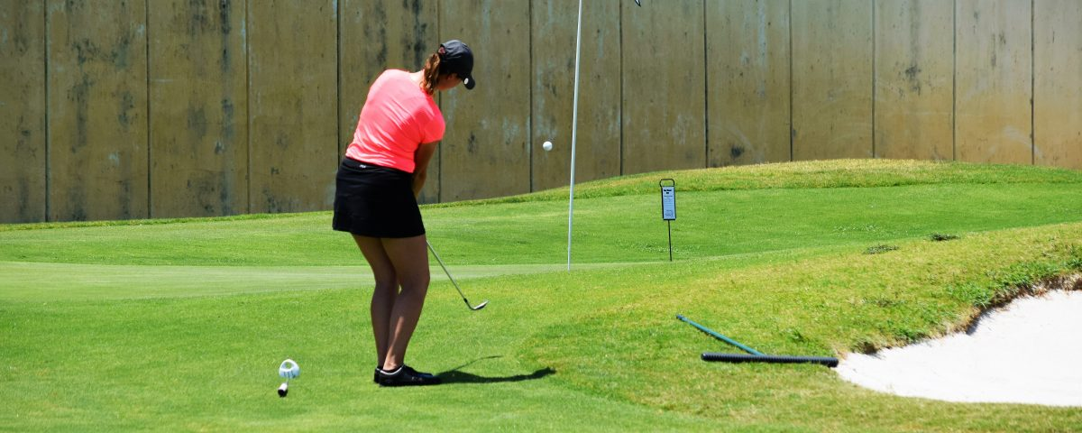 Armana Christianson hitting a one swing golf chip shot, because chipping is just a smaller version of your larger, full golf swing.